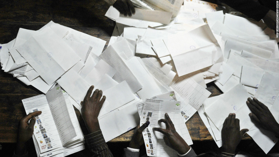 Poll officials count ballots at a polling centre following Kenya's national elections on March 4, 2013 in the country's western province in Kakamega.
