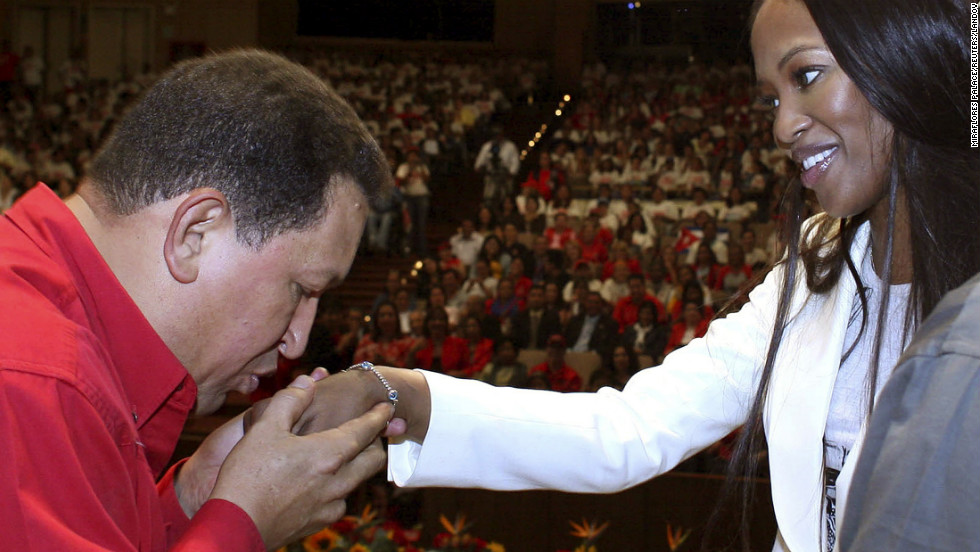 Chavez kisses the hand of British supermodel Naomi Campbell during a meeting in Caracas on October 31, 2007.