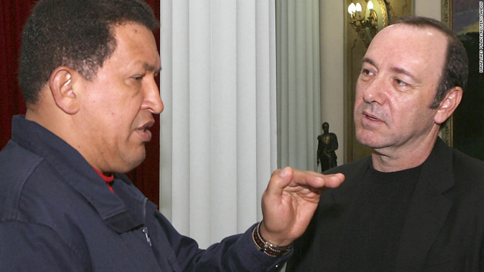 Chavez speaks to actor Kevin Spacey during a meeting at the Miraflores presidential palace on September 24, 2007.