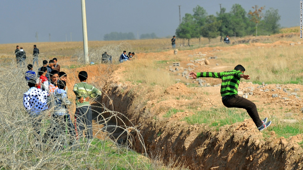 A Syrian jumps across the border into Turkey's Sanliurfa province in November 2012.