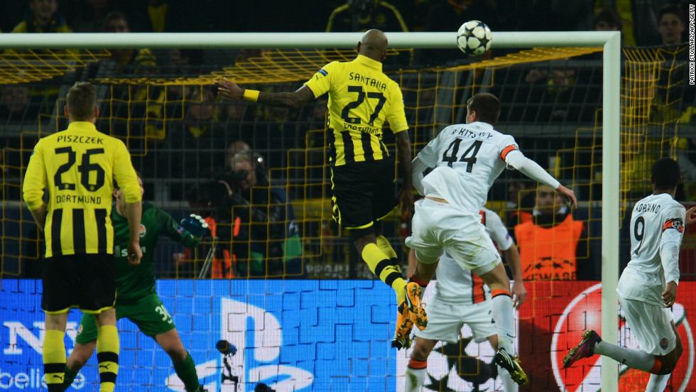 Felipe Santana rises to score Borussia Dortmund's opening goal in their 3-0 home win over Shakhtar Donetsk.