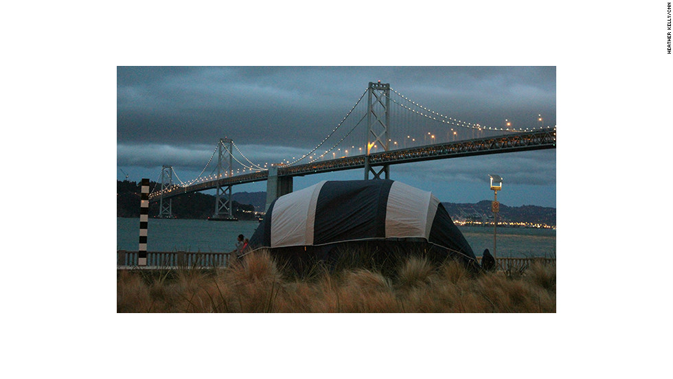 A tent set up in front of the Bay Bridge before the lighting show.