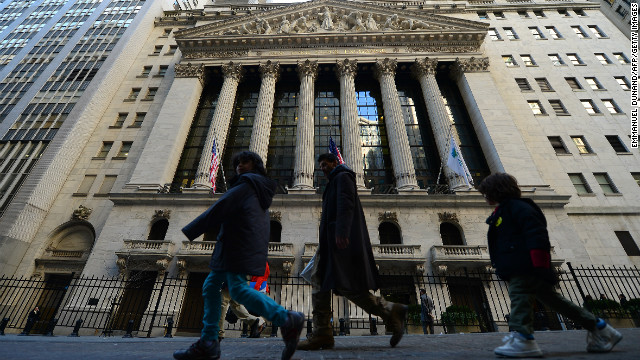 People walk by the New York Stock Exchange in New York, March 5, 2013. The Dow Jones industrial average surged to a record high at the opening bell, surpassing a key level in its recovery from the 2008 financial meltdown. The Dow Jones closed at 14253.77 points topping the previous record high of 14,164 achieved on October 9, 2007.