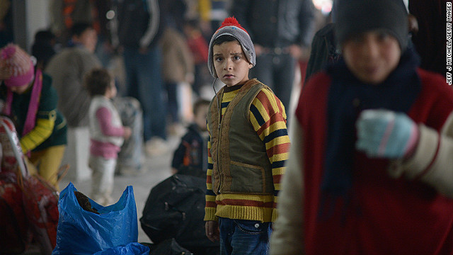 A boy looks on as new Syrian refugees arrive at the Za'atari refugee camp in Jordan on February 1, 2013.