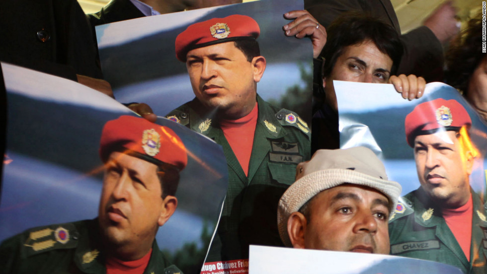 Palestinians hold portraits of Chavez during a rally in front of the Venezuelan Embassy, in the West Bank city of Ramallah, on March 6.