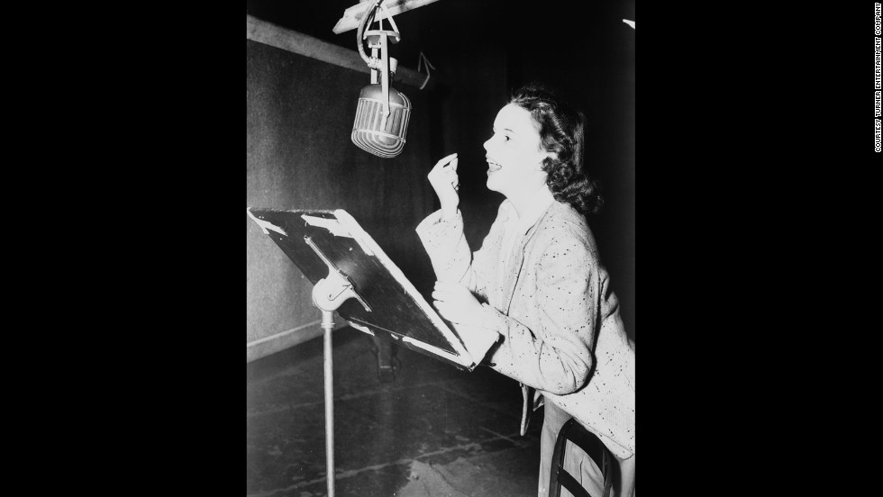 Judy Garland records a vocal track on the MGM orchestra stage.