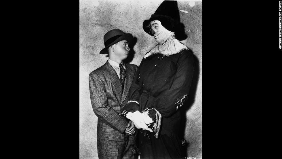 Ray Bolger as the Scarecrow visits with Mickey Rooney.