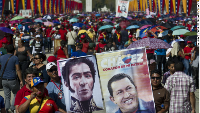 Venezuelans line up to pay their last respects to the late President Hugo Chavez in Caracas on Thursday.