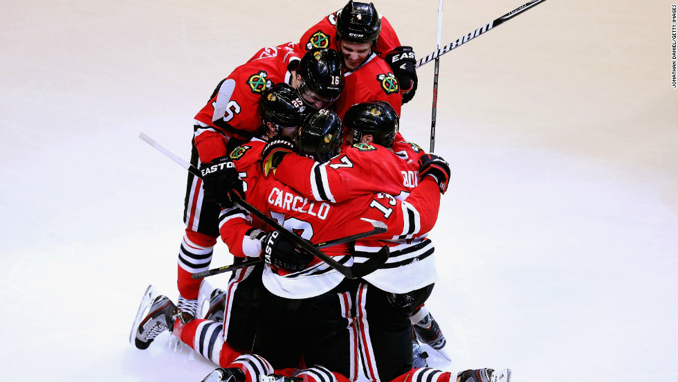 The Chicago Blackhawks are on an impressive unbeaten streak -- 21 games -- this season so far. Here, teammates celebrate their victory over the Colorado Avalanche on Wednesday, March 7, in the United Center in Chicago. Take a look at the Blackhawks, lately and through the years:
