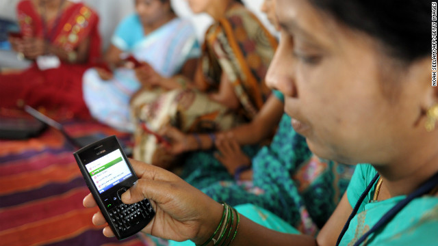 Indian villagers use mobile phones in Bibinagar village outside Hyderabad on March 7, the eve of International Women's Day.