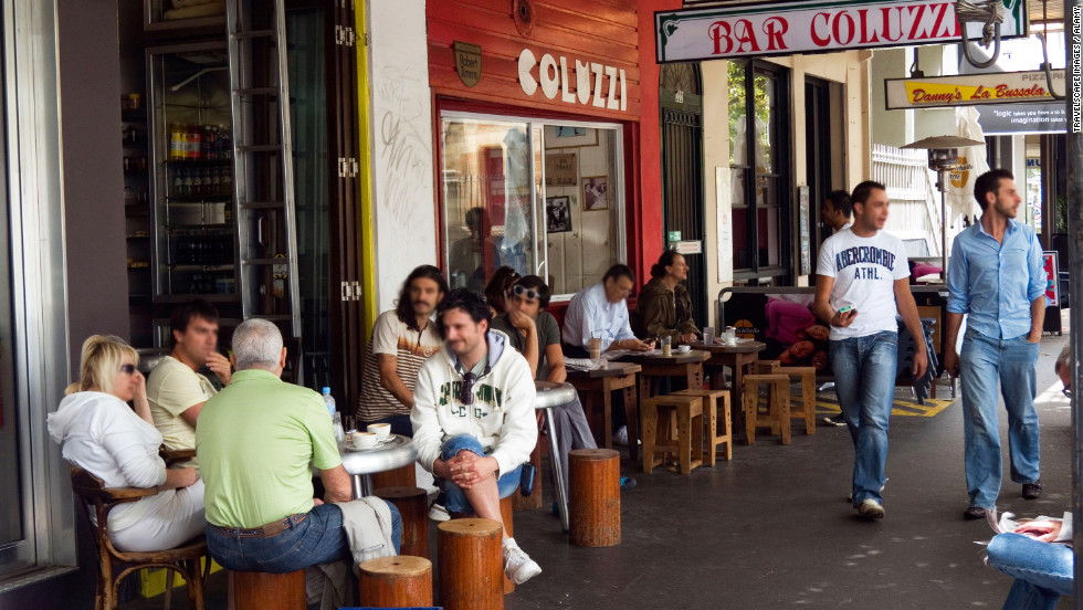 "Founded by Roman immigrant and former boxing champion Luigi Coluzzi, <a href=""http://www.travelandleisure.com/restaurants/bar-coluzzi-sydney-airport-syd"" target=""_blank"">the curbside café</a> has been Darlinghurst's de facto community center since 1957. Order a flat white (the espresso is as powerful as Luigi's uppercut), claim one of the foot-high sidewalk stools, and watch the entire neighborhood pass by. $"