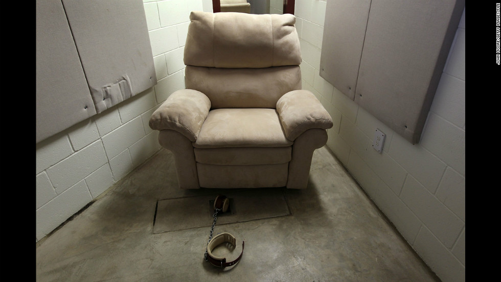 A seat and shackle await a detainee in the DVD room of a maximum-security detention center in March 2010.