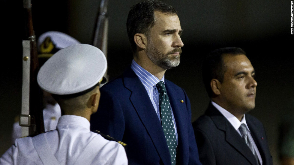 Spanish Crown Prince Felipe, center, arrives at Maiquetia Airport in Caracas on March 8.