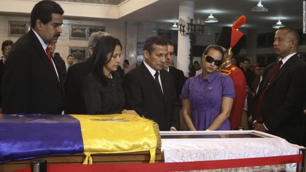 Peruvian President Ollanta Humala, center, views Chavez's body with his wife, Nadine Heredia, second left, on March 7.