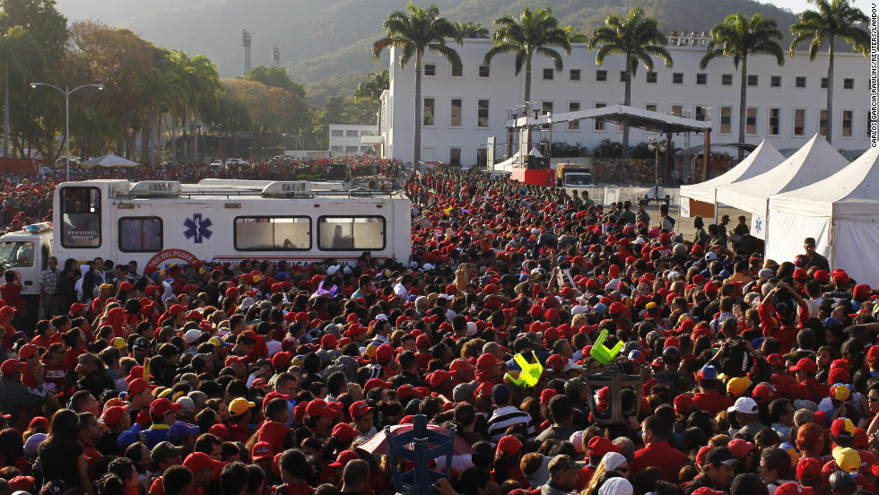 Supporters of Chavez gather as they wait for a chance to view his body on March 8.