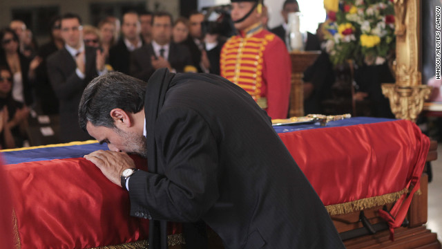 "Iran's President Mahmoud Ahmadinejad pays tribute to late Venezuelan President Hugo Chavez during the funeral service at the Military Academy in Caracas March 8, 2013, in this picture provided by the Miraflores Palace. Chavez will be embalmed and put on display ""for eternity"" at a military museum after a state funeral and an extended period of lying in state, acting President Nicolas Maduro said on Thursday. REUTERS/Miraflores Palace/Handout (VENEZUELA - Tags: POLITICS OBITUARY TPX IMAGES OF THE DAY) ATTENTION EDITORS - THIS IMAGE WAS PROVIDED BY A THIRD PARTY. THIS PICTURE WAS PROCESSED BY REUTERS TO ENHANCE QUALITY. AN UNPROCESSED VERSION WILL BE PROVIDED SEPARATELY. FOR EDITORIAL USE ONLY. NOT FOR SALE FOR MARKETING OR ADVERTISING CAMPAIGNS REUTERS /HANDOUT /LANDOV   Photographers/Source: HANDOUT/Reuters /Landov"
