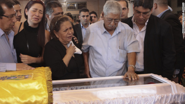 """Relatives of Venezuela's late President Hugo Chavez, his brother Adan (2nd L), his mother Elena Frias (4th L) and his father Hugo (2nd R), cry as they view his coffin during a wake at the military academy in Caracas March 7, 2013, in this picture provided by the Miraflores Palace. Chavez will be embalmed and put on display """"for eternity"""" at a military museum after a state funeral and an extended period of lying in state, acting President Nicolas Maduro said on Thursday. REUTERS/Miraflores Palace/Handout (VENEZUELA - Tags: POLITICS OBITUARY) REUTERS /HANDOUT /LANDOV   Photographers/Source: HANDOUT/Reuters /Landov"""