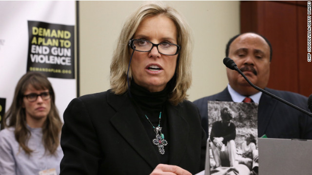 Kerry Kennedy, daughter of gun violence victim and former Attorney General Robert F. Kennedy, addresses a press conference with actress Amanda Peet (left) and Martin Luther King III.