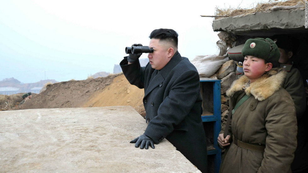 Kim uses a pair of binoculars to look south from the Jangjae Islet Defense Detachment, near South Korea's Taeyonphyong Island, in March 2013.