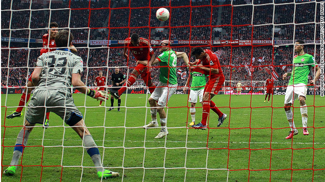 Jerome Boateng heads Bayern Munich to victory against Dusseldorf at the Allianz Arena on Saturday.