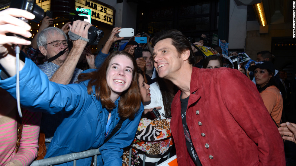 "Actor Jim Carrey poses with a fan on March 8 before the SXSW screening of his film ""The Incredible Burt Wonderstone."""