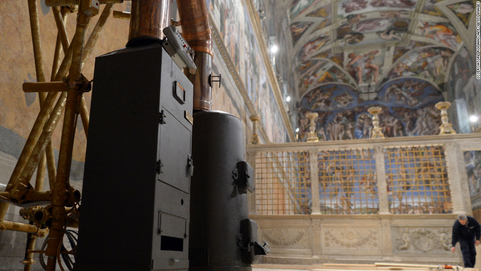The stoves that will signal the outcome of papal voting are installed inside the Sistine Chapel at the Vatican on March 8.