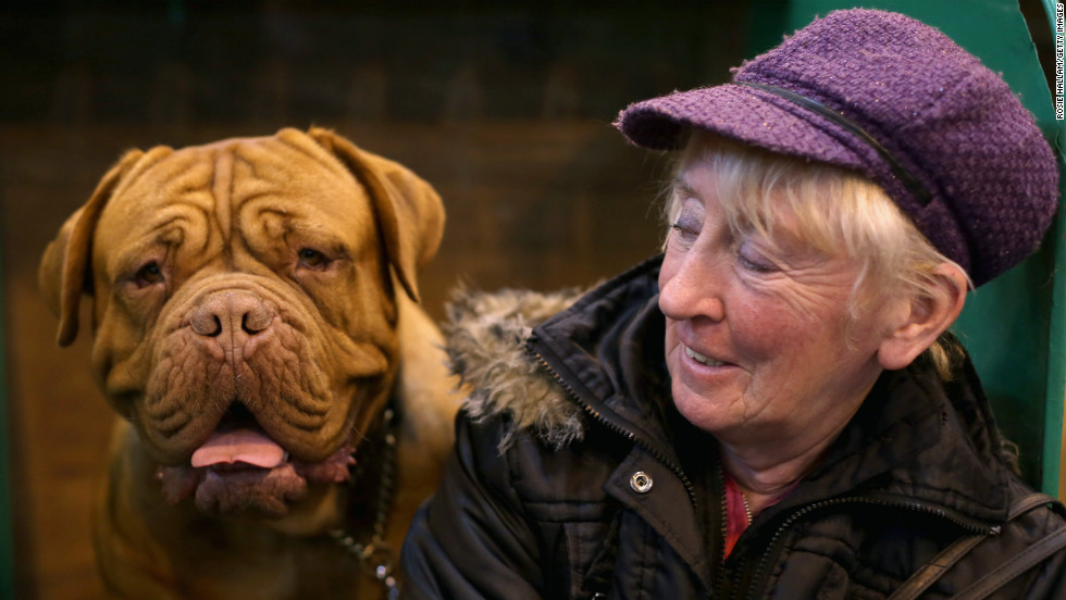 Jennifer Lomas and Isla, a French mastiff, stand by on March 10.