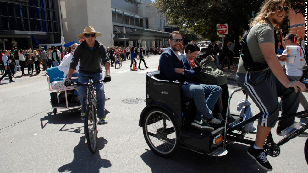SXSW attendees get a ride through the streets of Austin on March 10.