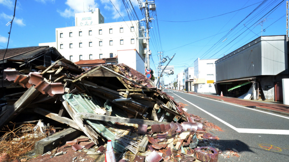 Collapsed houses still line on a street in Namie on Monday.