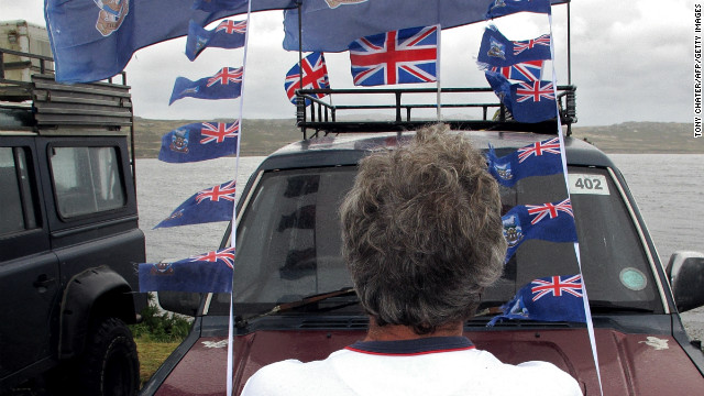 A man looks at flags of the Falkland Islands as a referendum takes place in Stanley, Falkland Islands on March 10, 2013. Residents of the Falkland Islands on Sunday voted in a referendum intended to show the world that they want to stay British amid increasingly bellicose claims by Argentina. AFP PHOTO / Tony Chater (Photo credit should read TONY CHATER/AFP/Getty Images)
