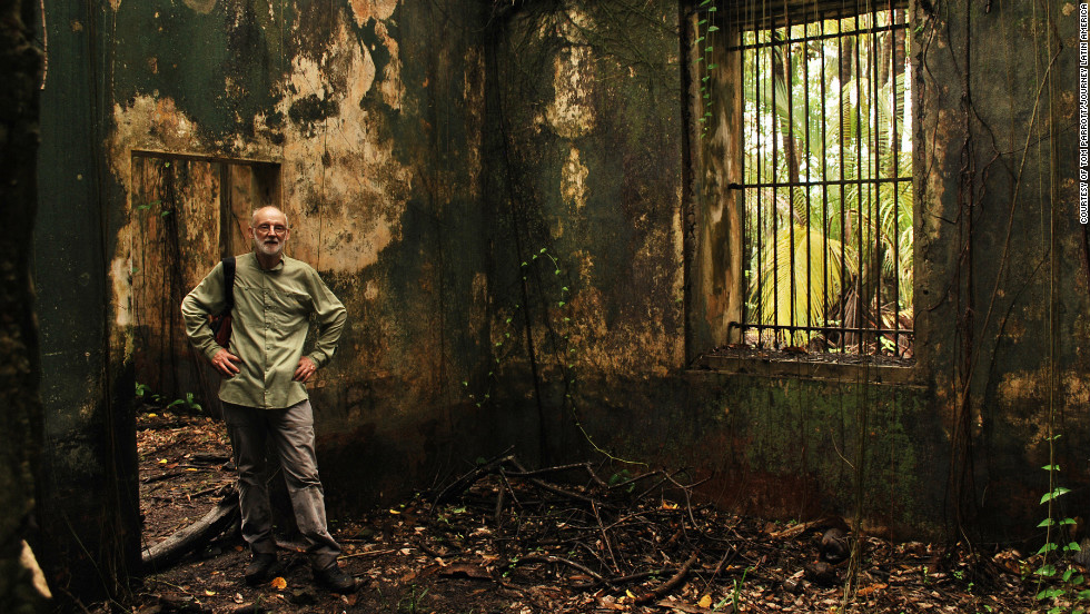 Stepping inside. Visitors can venture inside the abandoned cells on Ile St. Joseph, French Guiana.