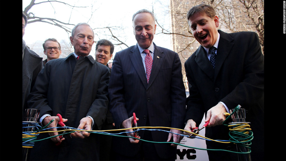 From left, Bloomberg, New York Sen. Charles Schumer and Ben Fried, chief information officer for Google, cut Ethernet cables at a news event where it was announced that free Wi-Fi would be provided to the Manhattan neighborhood of Chelsea in January 2013.