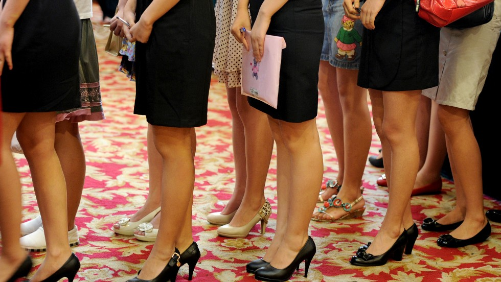 Short hem lines show off the legs of young Chinese women in Anhui province. They all hope to ace an interview and land a flight attendant job. In South Korea, Asiana Airlines cabin crew have been campaigning for changes to uniforms that currently dictate female flight attendants to wear skirts.