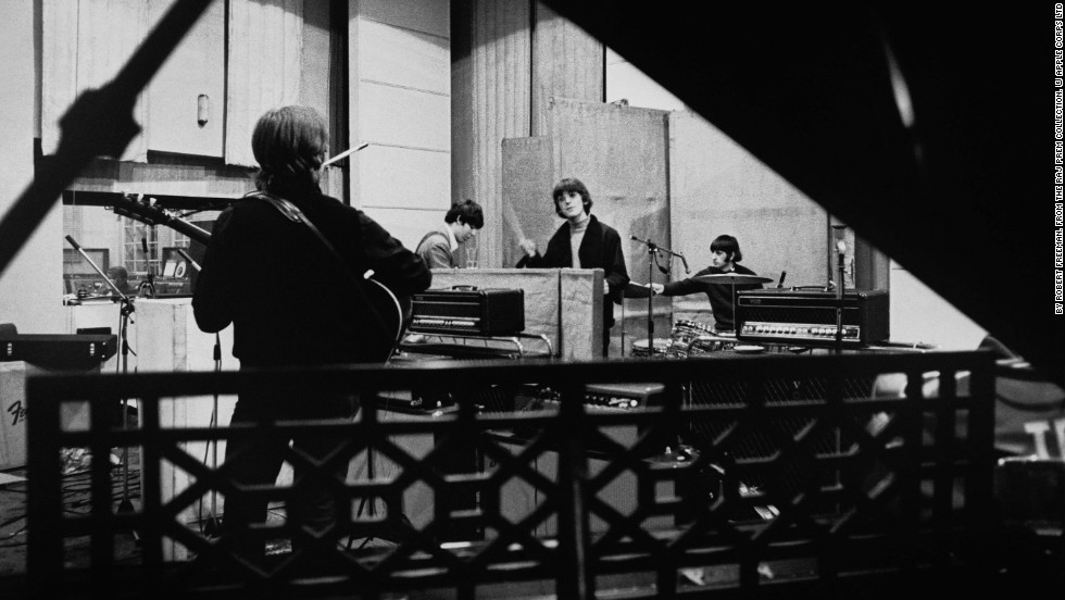 "The Beatles are seen recording their seventh album, ""Revolver,"" at Abbey Road Studios in April 1966 before embarking on a world tour. Revolver was released in August that year and went straight to No. 1 in the U.S. and UK."