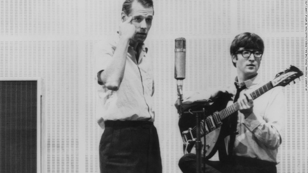 John Lennon is seen with George Martin, the band's producer often dubbed the fifth Beatle, who first signed the Beatles to his Parlophone label when they were unknown. He then oversaw their rise to fame and wrote or performed many of the orchestral arrangements in their songs.