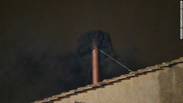 Black smoke rises from the chimney on the roof of the Sistine Chapel meaning that cardinals failed to elect a new pope in the first ballot of their secret conclave on March 12, 2013 at the Vatican. AFP PHOTO / VINCENZO PINTO (Photo credit should read VINCENZO PINTO,VINCENZO PINTO/AFP/Getty Images)