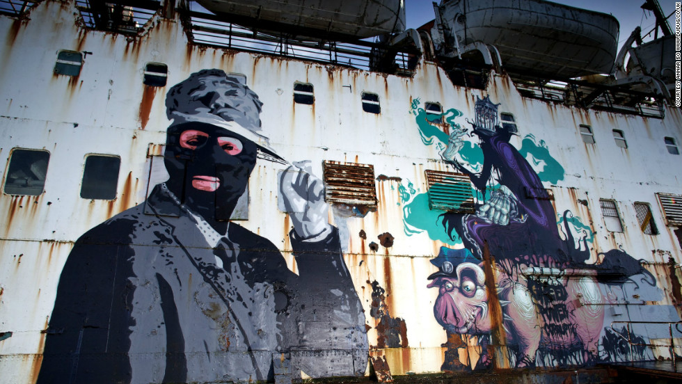 """This balaclava-clad businessman was created by British artist <a href=""""http://bungleart.blogspot.co.uk/"""" target=""""_blank"""">Bungle</a>, and is titled """"The Face of Authority."""" All the artists work on a volunteer basis."""