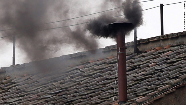 Black smoke is seen coming from the chimney on the roof of the Sistine Chapel as Cardinals enter their 2nd day of the conclave on March 13, 2013 in Vatican City, Vatican.