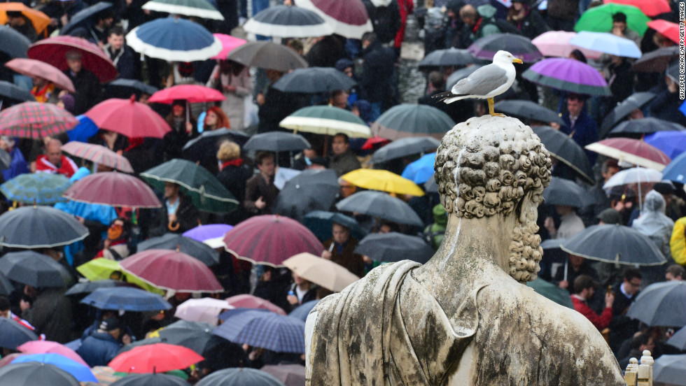 A seagull stands on a statue of St. Peter as Catholics and other observers await the results on March 13.