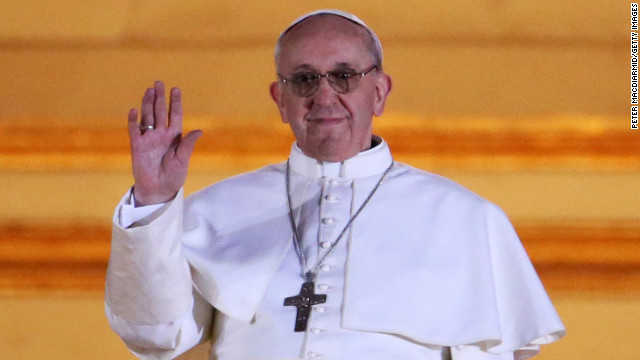 The new pope waves to cheering crowd