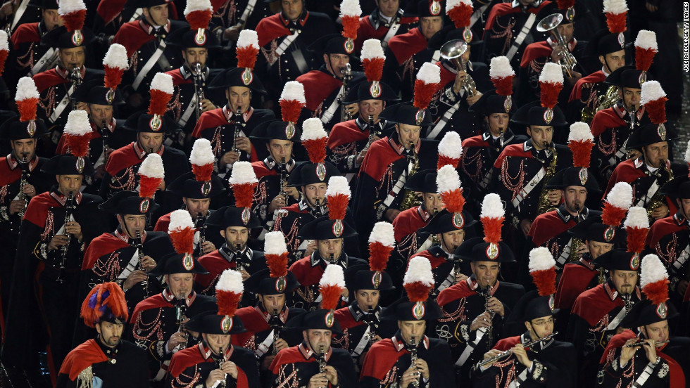 A marching band performs before the introduction of the new pope.