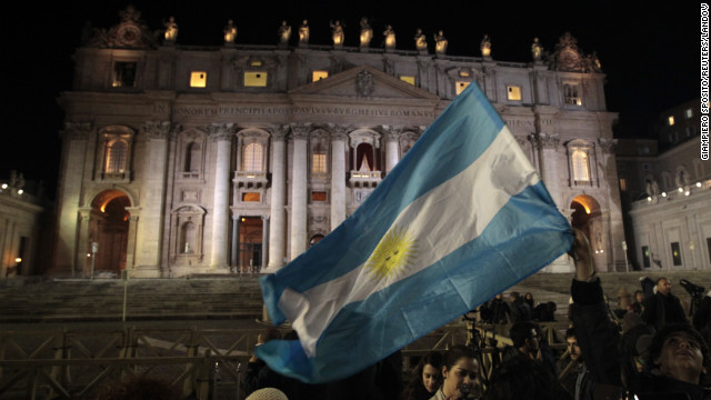 Image #: 21584951    Faithful wave Argentina's flag after white smoke rose from the chimney above the Sistine Chapel, indicating a new pope has been elected at the Vatican, March 13, 2013. Jorge Mario Bergoglio of Argentina was elected in a surprise choice to be the new leader of the troubled Roman Catholic Church on Wednesday, and said he would take the name Francis I.            REUTERS/Giampiero Sposito (VATICAN  - Tags: RELIGION TPX IMAGES OF THE DAY)         REUTERS /GIAMPIERO SPOSITO /LANDOV