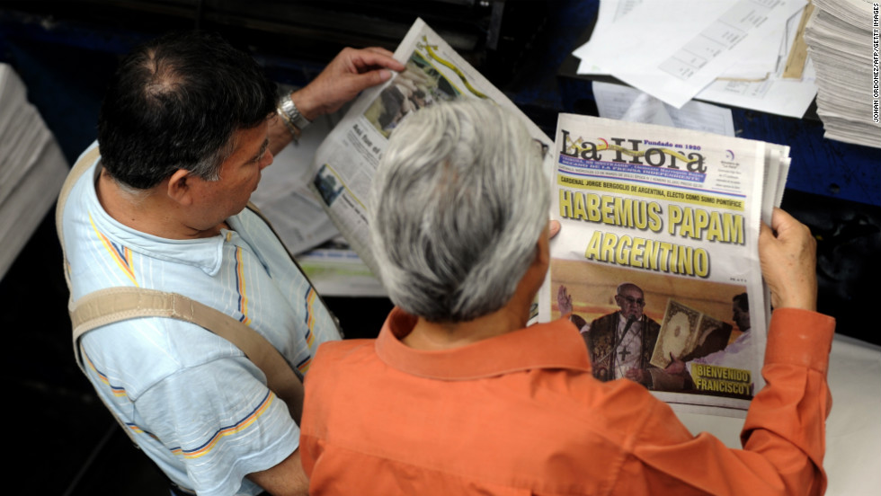 Employees of the evening newspaper La Hora in Guatemala City, Guatemala, review printed editions with the announcement of the election of Pope Francis.