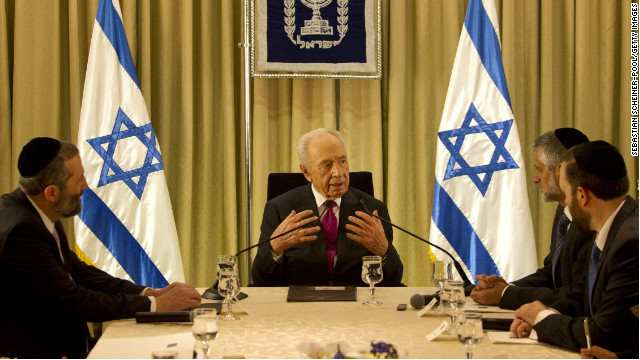 President Shimon Peres (C) sits with Shas Party leaders at the President's residence on  January 31, 2013, Jerusalem.
