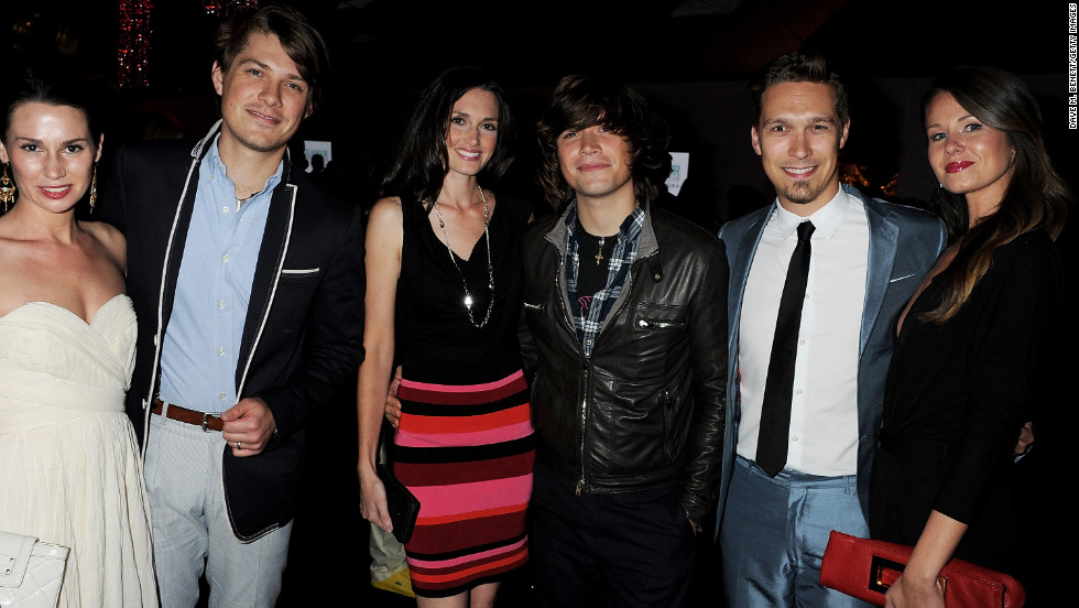 The brothers attend a party with their wives -- Natalie, left, Kate, center, and Nicole -- in London in 2011.