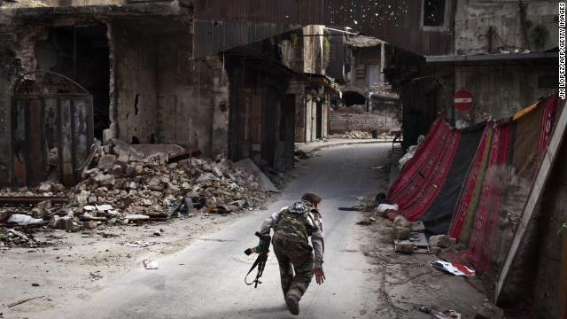 A Syrian rebel crosses a street while trying to dodge sniper fire in the old city of Aleppo in northern Syria on March 11, 2013. Syria warned on March 12 it is ready to fight 'for years' against rebels, as world powers worked on a new initiative to find regime officials suitable for peace talks with the opposition.