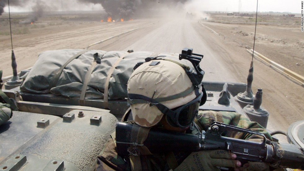 A U.S. Marine from Task Force Tarawa engages Iraqi forces from an armored assault vehicle on March 23, 2003, in the southern city of Nasiriyah.