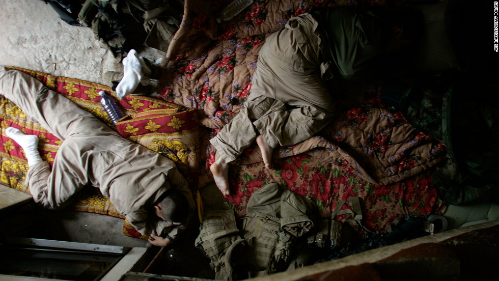 U.S. Marines sleep at their patrol base in the area known as Zaidon in Al Anbar province on May 12, 2007.