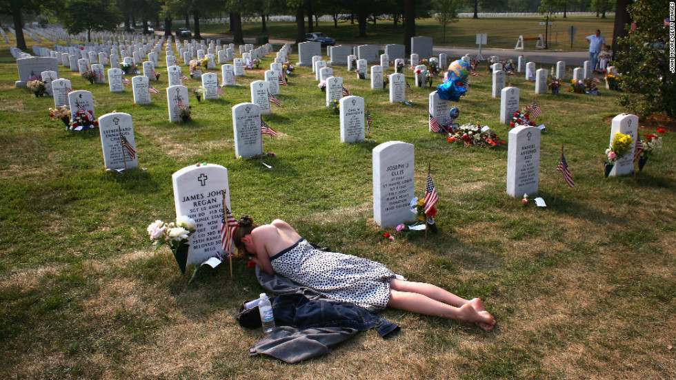 Mary McHugh mourns her fiance, Sgt. James Regan, at Arlington National Cemetery in Washington on May 27, 2007. The American Special Forces soldier was killed by an IED in Iraq in February.