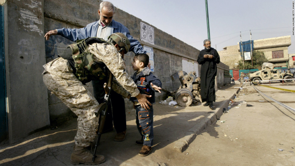An Iraqi soldier searches a boy at a polling station in Baghdad on January 31, 2009. People across the country voted to fill 440 provincial council seats.